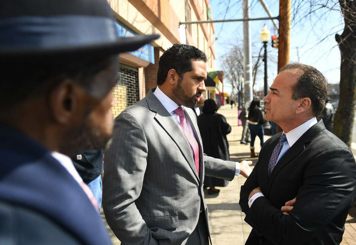 State Sen. Dennis Bradley, left, speaks with Bridgeport Mayor Joe Ganim last month.
