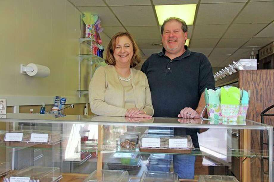 Debbie and Mark Powell pose behind one of their candy counters at SugarHouse Sweets and Gifts. Debbie, who is the village manager of Cass City, is predicting that the opening of their store will kickstart some momentum in downtown. (Mike Gallagher/Huron Daily Tribune)