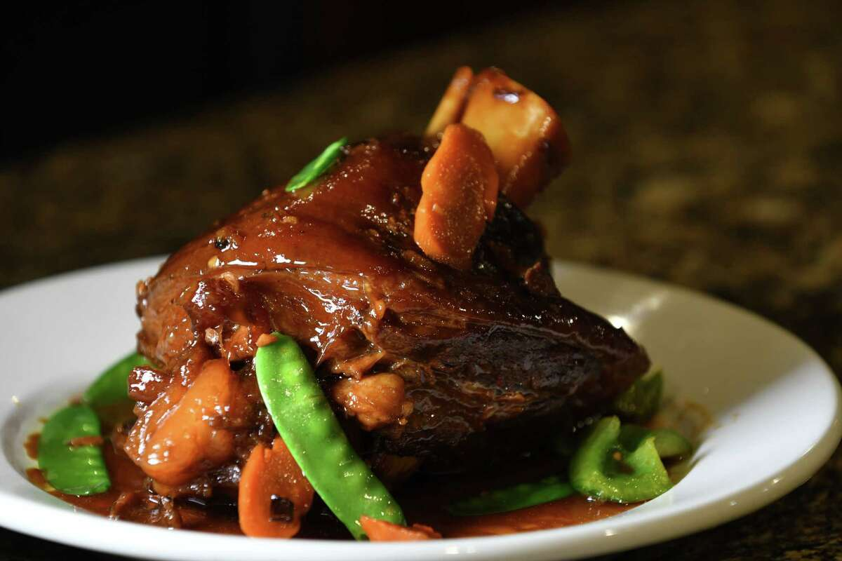 Pata tim, braised pork hock, from D&L Hospitality on Thursday, March 14, 2019, on Remsen Street in Cohoes, N.Y. The restaurant specializes in Filipino cuisine. (Will Waldron/Times Union)