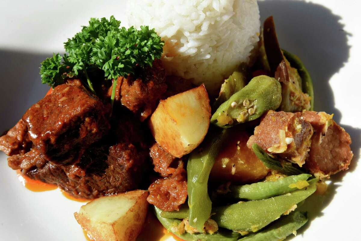 Beef caldereta with pinakbet and rice from D&L Hospitality on Thursday, March 14, 2019, on Remsen Street in Cohoes, N.Y. The restaurant specializes in Filipino cuisine. (Will Waldron/Times Union)