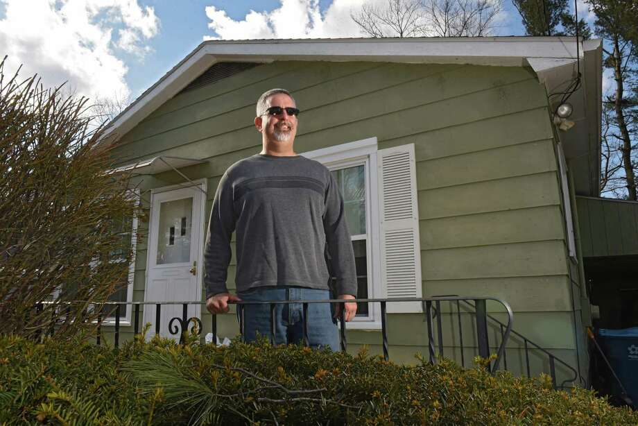 William Day stands in front of his home on Tuesday, March 19, 2019 in Colonie, N.Y. Day used a benefit in his GI Bill to get a home loan. (Lori Van Buren/Times Union) Photo: Lori Van Buren / 40046431A