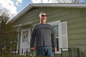 William Day stands in front of his home on Tuesday, March 19, 2019 in Colonie, N.Y. Day used a benefit in his GI Bill to get a home loan. (Lori Van Buren/Times Union)