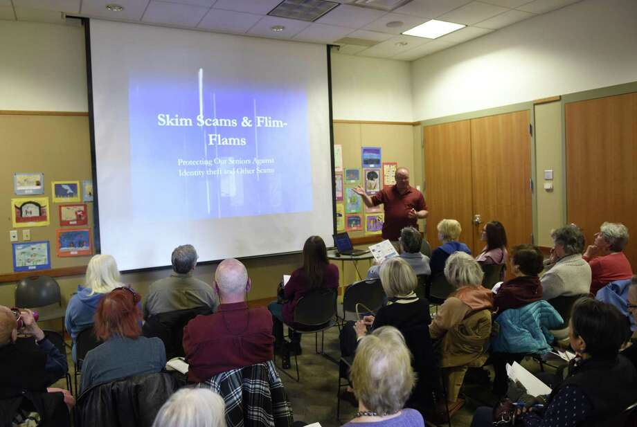 Greenwich Police Detective Mark Solomon presents Crime Prevention and Elderly Scams at Cos Cob Library in the Cos Cob section of Greenwich, Conn. Thursday, March 28, 2019. At Home in Greenwich and the Greenwich Police Department's Community Impact Section teamed up to give seniors tips on how to spot and avoid various types fraud, identity theft and cybercrimes. Photo: Tyler Sizemore / Hearst Connecticut Media / Greenwich Time
