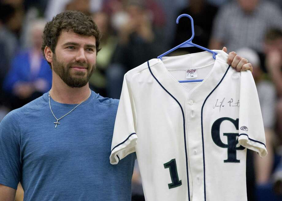 Tampa Bay Rays pitcher Austin Pruitt holds up a signed jersey as his number is retired during a ceremony for the former College Park pitcher at College Park High School, Friday, Jan. 26, 2018, in The Woodlands. Photo: Jason Fochtman, Staff Photographer / Houston Chronicle / © 2018 Houston Chronicle