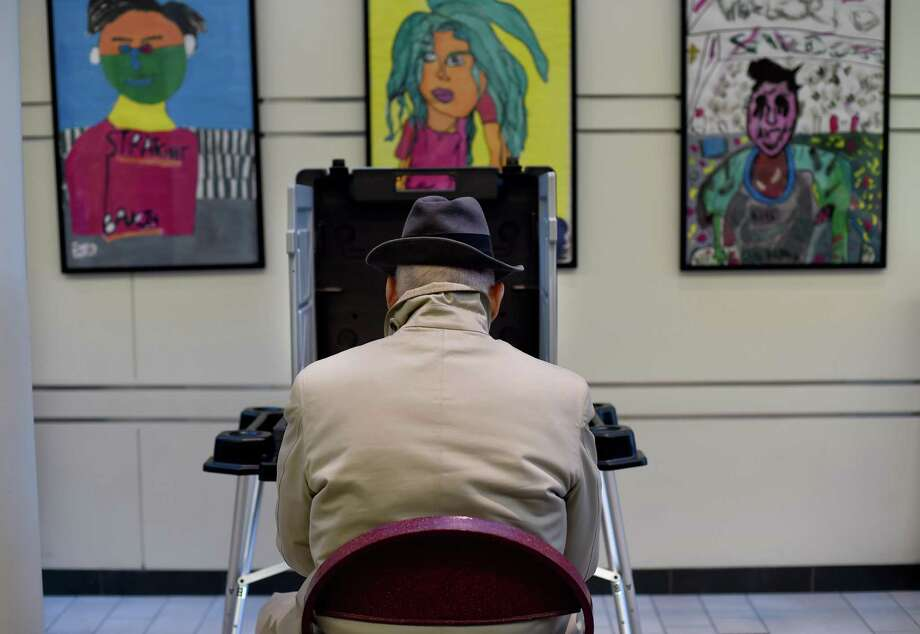 Voters cast their ballots in the presidential election at the Greenwich High School polling place in Greenwich, Connecticut November 8, 2016. Photo: TIMOTHY A. CLARY / AFP /Getty Images / This content is subject to copyright.