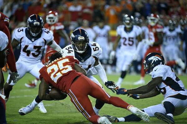 4fc1f91a11c 1of2Kansas City Chiefs running back Jamaal Charles (25) is tackled by  Denver Broncos linebacker Brandon Marshall (54) as he fumbles the ball for  a turnover ...