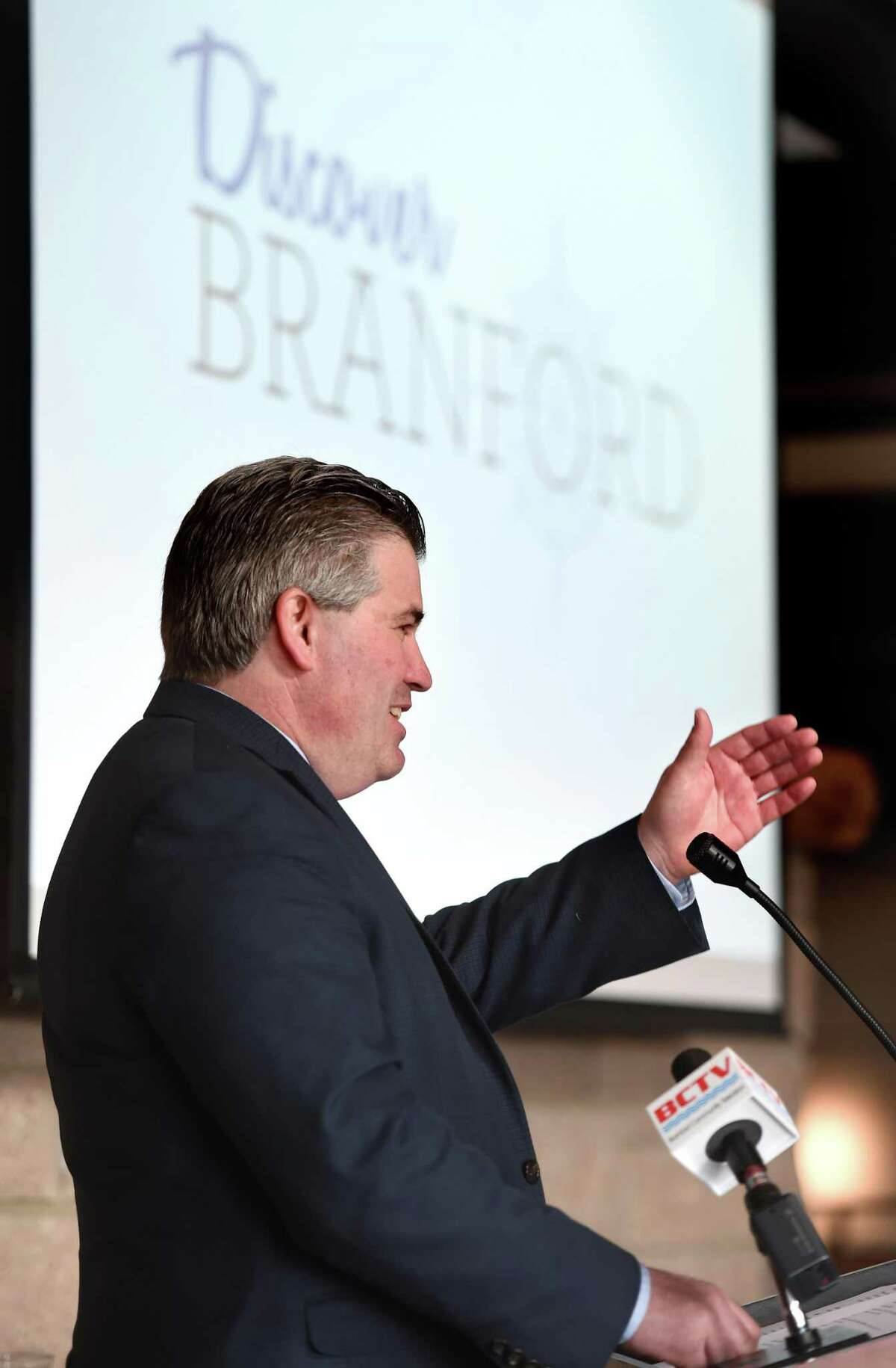 Branford First Selectman James B. Cosgrove delivers the State of the Town address during the 2019 Branford Economic Forum at the Stony Creek Brewery in Branford on March 28, 2019.