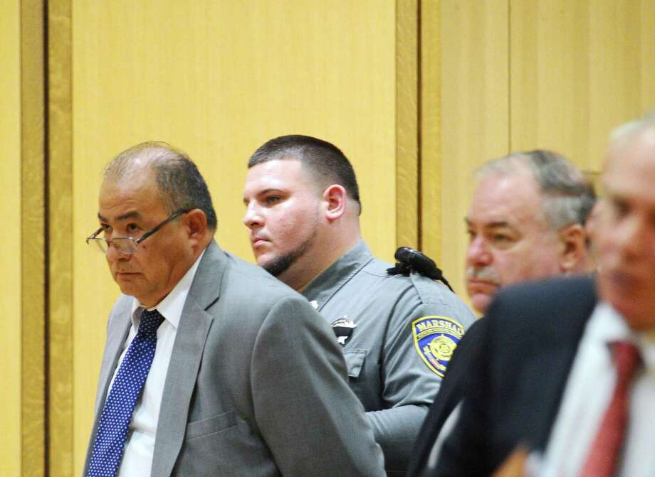 Businessman Miguel Juarez, left, sits with attorneys Paul Spinella, center, and Robert Bello to await sentencing at the Connecticut Superior Court in Stamford on Thursday, Feb. 25, 2016. Juarez was charged with attempted murder by a jury. Photo: Michael Cummo / Hearst Connecticut Media / Stamford Advocate