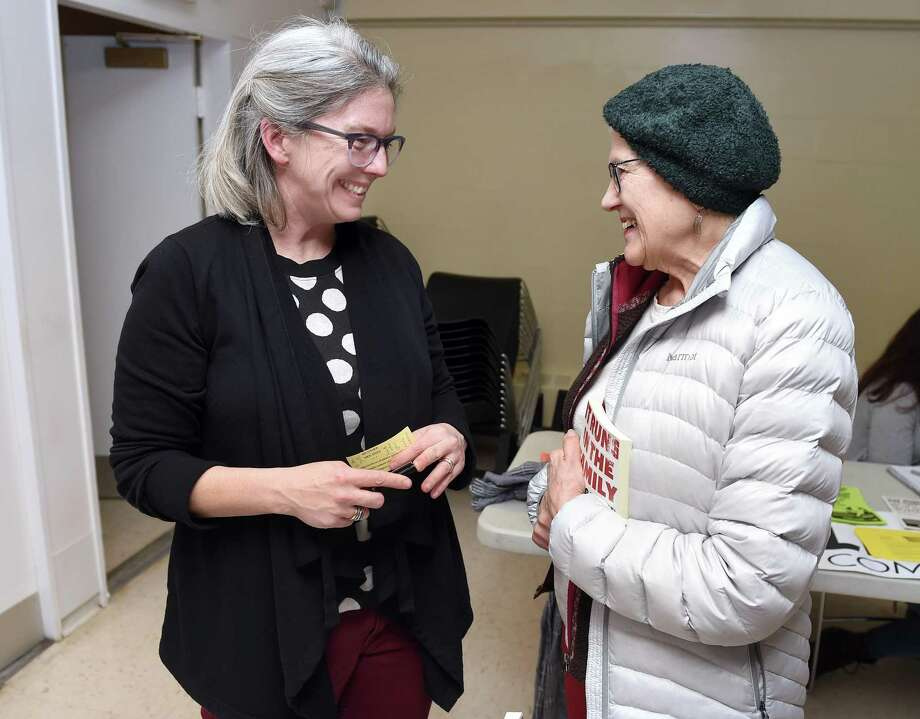 Peace activist Frida Berrigan (left) talks with Maz Burbank of New Haven before delivering a Promoting Enduring Peace talk on her family's long opposition to nuclear weapons. Photo: Arnold Gold / Hearst Connecticut Media / New Haven Register