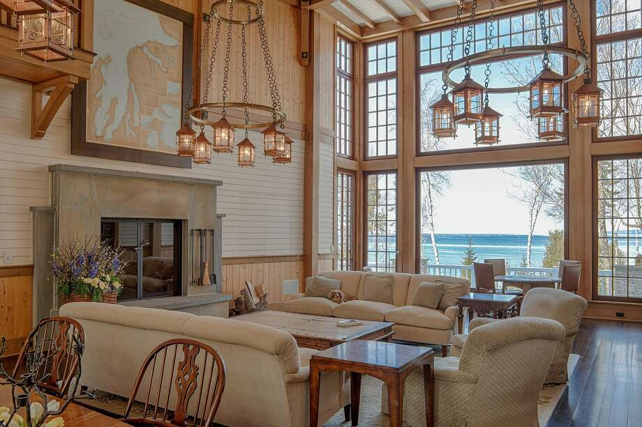 Lanterns and oversized picture windows illuminate and brighten the great room of 6744 Preserve Drive North in Bay Harbor, Mich. Photo: Chris Van Winkle Photography