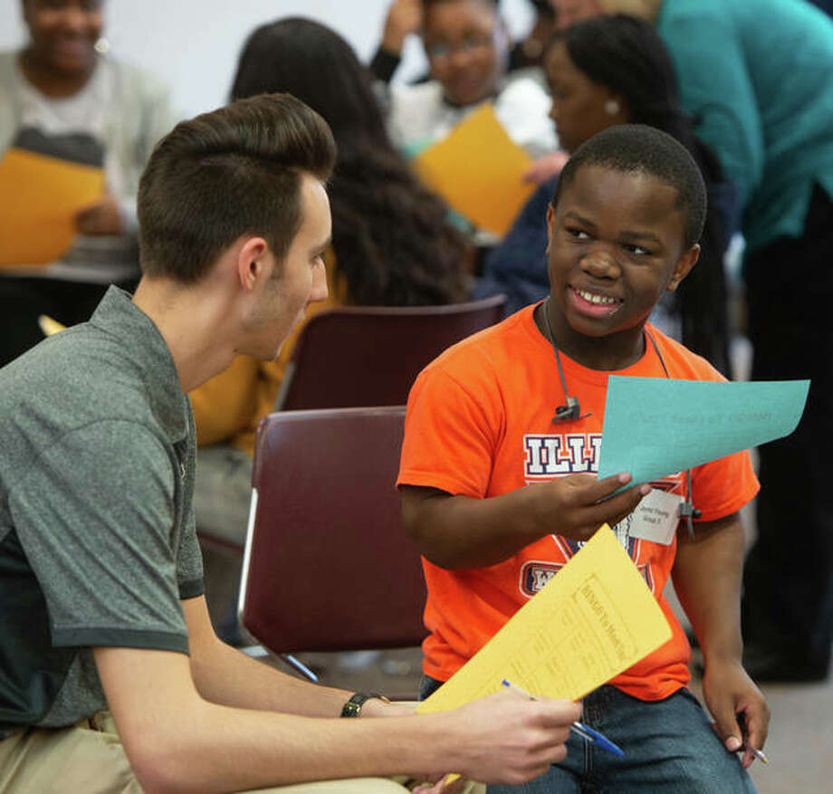 Jason Pappas, a sophomore in the College of Arts and Sciences, talks with SIUE Charter High School freshman Jaymz Young. Photo: Photo Courtesy Of Patricia Merritt