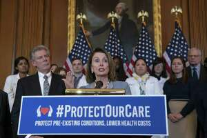 "Speaker of the House Nancy Pelosi, D-Calif., joined at left by Energy and Commerce Committee Chair Frank Pallone, D-N.J., speaks at an event to announce legislation to lower health care costs and protect people with pre-existing medical conditions, at the Capitol Tuesday. The Democratic action comes after the Trump administration told a federal appeals court that the entire Affordable Care Act, known as ""Obamacare,"" should be struck down as unconstitutional."