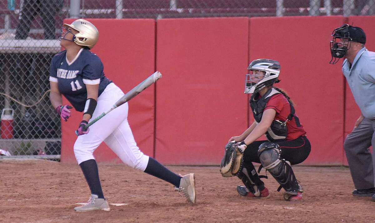 Notre Dame-Fairfield's Breana Brown, left, watches a ball get put into play along with Masuk catcher Katie Pullen during Thursday's SWC semifinal at DeLuca Field in Stratford.