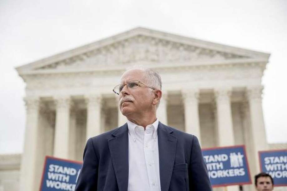 Mark Janus stands outside the Supreme Court on June 27, 2018, after the court rules in a setback for organized labor that states can't force government workers to pay union fees.