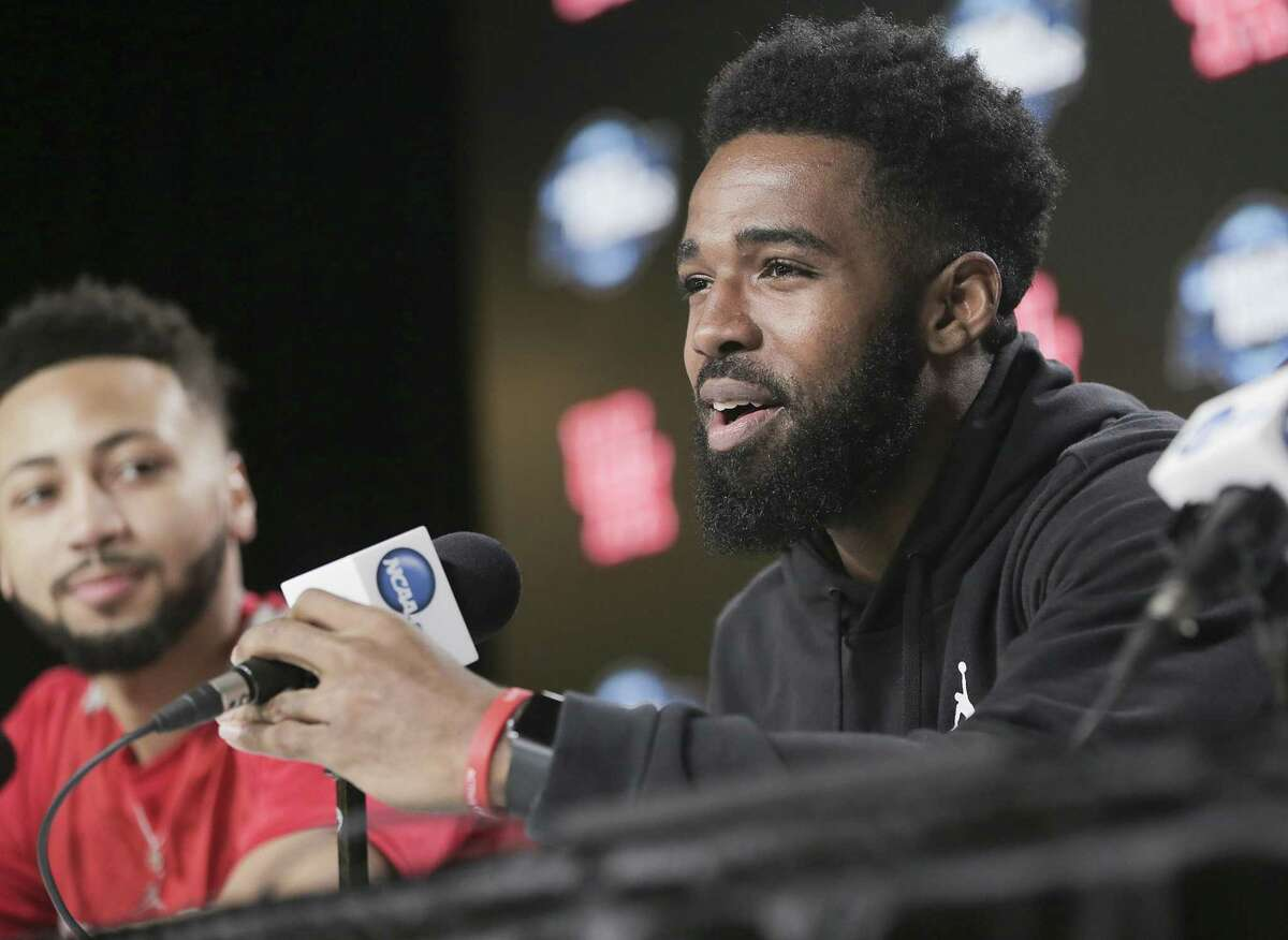 Galen Robinson Jr., left, and Corey Davis Jr. were at the center of the UH basketball program's revival the past two years, including the Cougars' first Sweet 16 trip in 35 years.