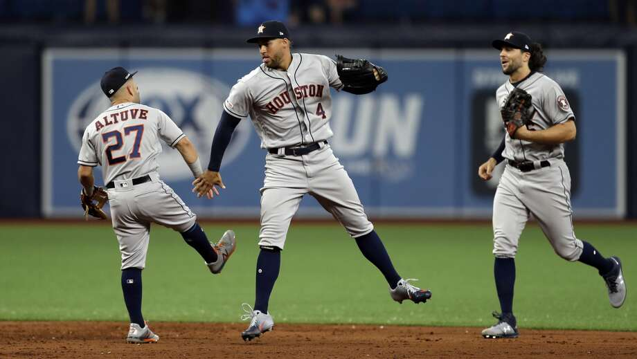 Houston Astros second baseman Jose Altuve (27), center fielder George Springer (4) and center fielder Jake Marisnick (6) celebrate after defeating the Tampa Bay Rays during a baseball game Thursday, March 28, 2019, in St. Petersburg, Fla. (AP Photo/Chris O'Meara) Photo: Chris O'Meara/Associated Press