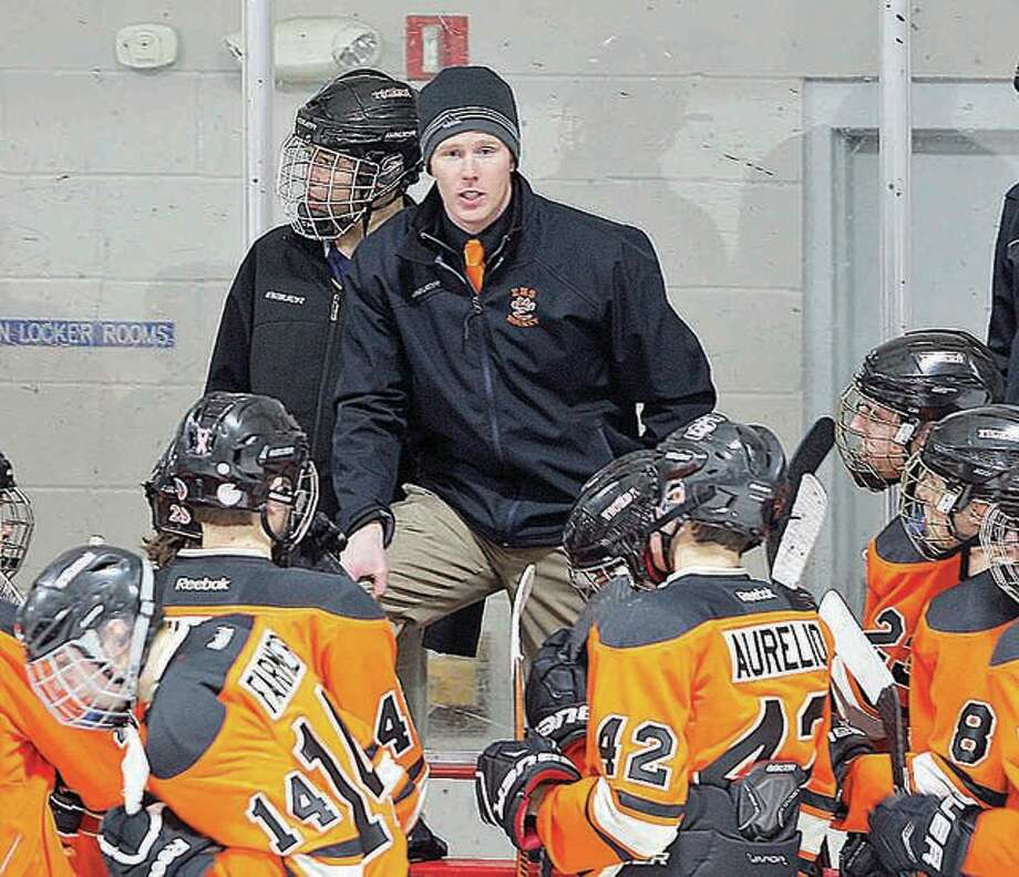 Edwardsville hockey coach Jason Walker talks to his team between period during a 2018 game. The Tigers opened play at the USA High School Nationals Thursday with a victory over Utah state champion Viewmont High School. Photo: Scott Kane File Photo | For The Telegraph