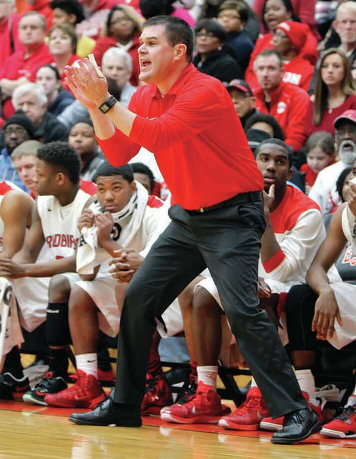 Alton boys basketball coach Eric Smith encourages his team from the bench during a game last season at Alton High. Smith has stepped down after seven seasons. Photo: Billy Hurst File Photo | For The Telegraph