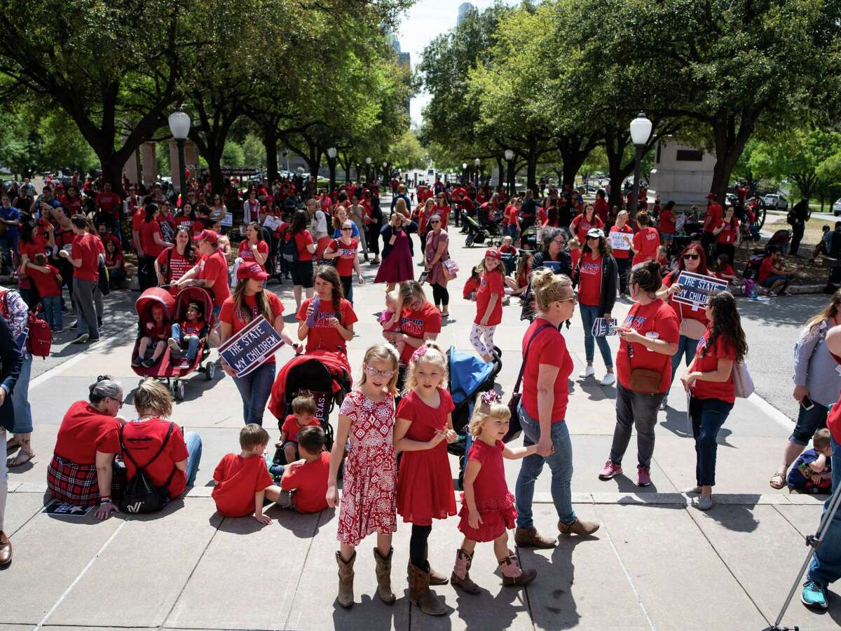 Parents and their children gather together on the Texas Capitol steps during a rally held by Texans for Vaccine Choice in Austin on Thursday, March 28, 2019.