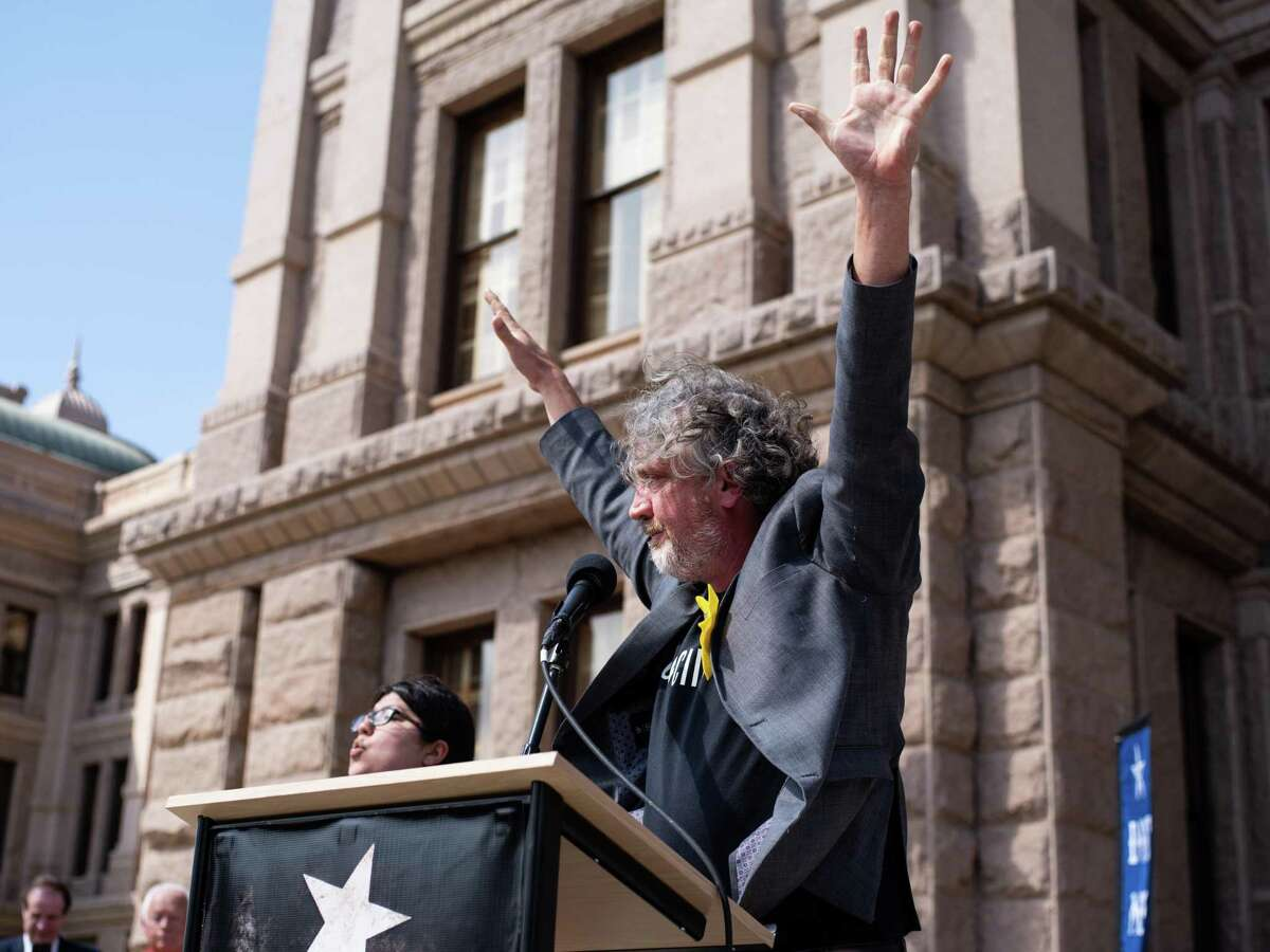 """Del Bigtree, an activist opposing the use of vaccines on children, producer of the film """"Vaxxed,"""" and founder of the non-profit, Informed Consent Action Network, speaks from the podium during a rally held by Texans for Vaccine Choice at the Texas State Capitol in Austin on Thursday, March 28, 2019."""