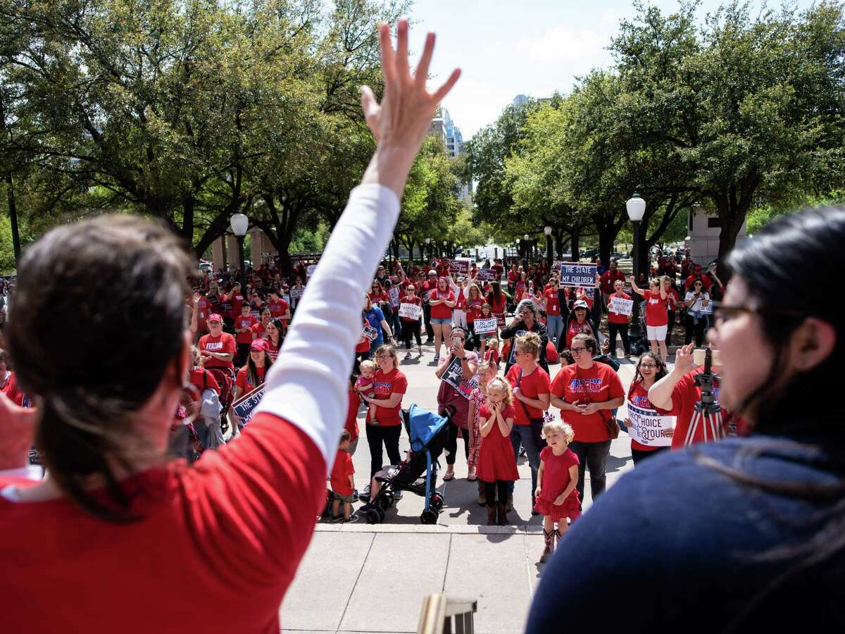 Star Stevens, a member care coordinator with Texans for Vaccine Choice, left, speaks from the Texas Capitol steps during a rally in Austin on Thursday, March 28, 2019.