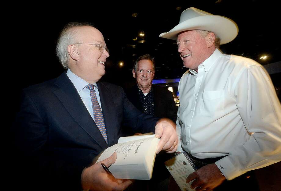Karl Rove, Senior Advisor and Deputy Chief of Staff to President George W. Bush, talks with Carl Griffith (right) and Vernon Pierce as he autographs books before addressing the crowd at the Texas Energy Museum's Blowout 2019 at the Civic Center. Photo taken Thursday, March 28, 2019 Kim Brent/The Enterprise Photo: Kim Brent / The Enterprise / BEN