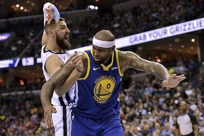 11c9a5635 Golden State Warriors center DeMarcus Cousins (0) and Memphis Grizzlies  center Jonas Valanciunas struggle for position in the first half an NBA  basketball ...
