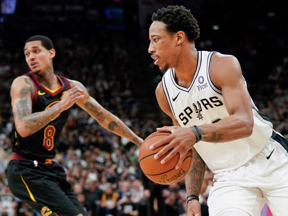 San Antonio Spurs' DeMar DeRozan, right, drives around Cleveland Cavaliers' Jordan Clarkson during the first half of an NBA basketball game, Thursday, March 28, 2019, in San Antonio. (AP Photo/Darren Abate) Photo: Darren Abate, Associated Press / Copyright 2019 The Associated Press. All rights reserved.