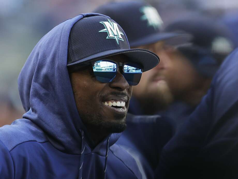 Seattle Mariners second baseman Dee Gordon sits in the dugout during a spring training baseball game against the San Diego Padres, Tuesday, March 26, 2019, in Seattle. (AP Photo/Ted S. Warren) Photo: Ted S. Warren / Associated Press