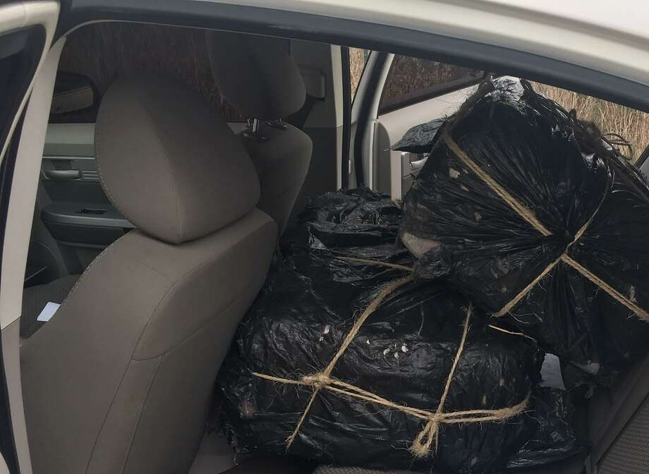 Border Patrol agents seized 260 pounds of marijuana discovered in a white Chrysler sedan after a pursuit on FM 255. Photo: /