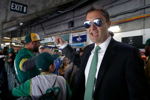 Team president Dave Kaval walks through the stands to greet fans before the Oakland A's home opener against the Los Angeles Angels in Oakland, Calif. on Thursday, March 28, 2019.