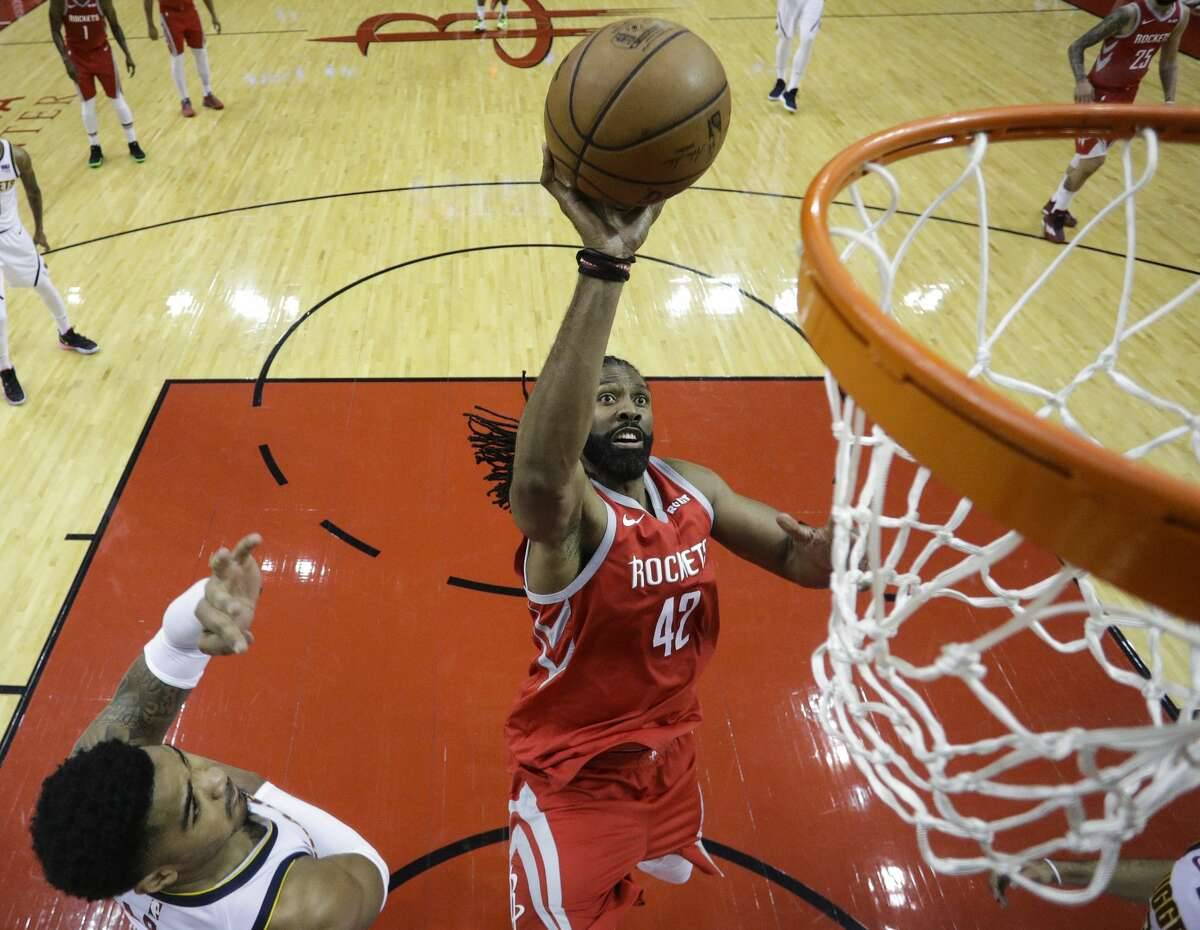 Houston Rockets center Nene (42) takes a shot at the basket against the Denver Nuggets during the first half of an NBA basketball game at Toyota Center on Thursday, March 28, 2019, in Houston.