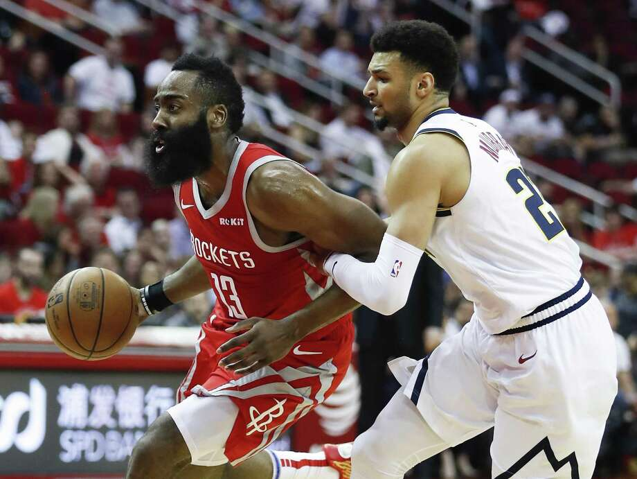 Houston Rockets guard James Harden (13) is grabbed by Denver Nuggets guard Jamal Murray (27) as he takes the ball in the lane during the first half of an NBA basketball game at Toyota Center on Thursday, March 28, 2019, in Houston. Photo: Brett Coomer, Houston Chronicle / Staff Photographer / © 2019 Houston Chronicle