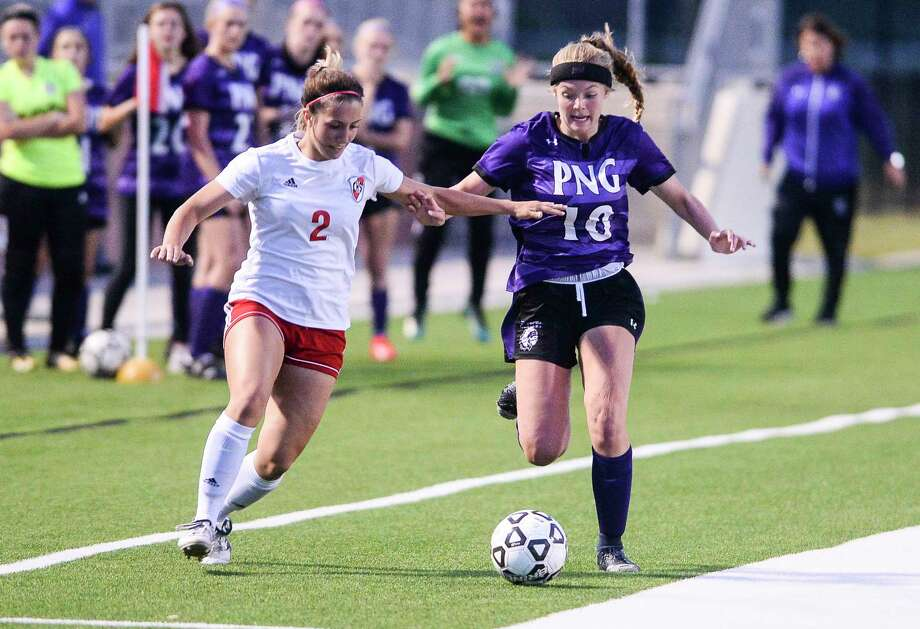 PN-G's Hannah LeBlanc tries to keep the ball away from a Crosby defender during the game at BISD Memorial Stadium Thursday night. Photo taken on Thursday, 03/28/19. Ryan Welch/The Enterprise Photo: Ryan Welch, The Enterprise / ©Ryan Welch