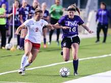 PN-G's Hannah LeBlanc tries to keep the ball away from a Crosby defender during the game at BISD Memorial Stadium Thursday night. Photo taken on Thursday, 03/28/19. Ryan Welch/The Enterprise