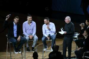 Fabricio Oberto, left, San Antonio Spurs teammate of Manu Ginobili, and members of the Gold Medal Argentinian basketball team speak about Ginobili during halftime of the Cleveland Cavaliers at San Antonio Spurs game on Thursday night, March 28, 2019. Ginobili played for the Spurs from 2002-2018.