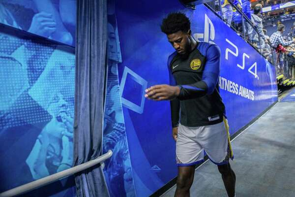 a7c079bcc60 1of10The Warriors' Jordan Bell reportedly charged a candle on assistant  coach Mike Brown's hotel bill, and wound up suspend ed one game.