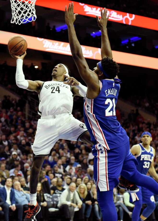 f911a7cad0ed Brooklyn Nets  Rondae Hollis-Jefferson (24) goes up to shoot as Philadelphia