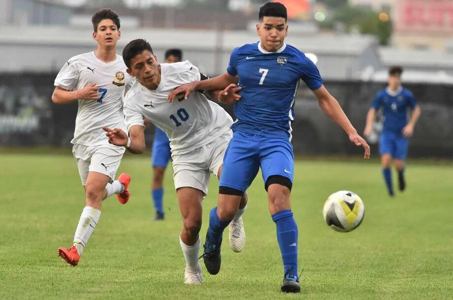 JAy's Jose Reyes (7) and MacArthurs Samuel Villegas battle for the ball during their UIL Class 6A match Wednesday night. Photo: Robin Jerstad, Photo Correspondent / ROBERT JERSTAD