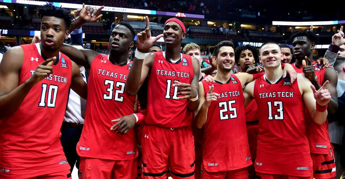 ANAHEIM, CALIFORNIA - MARCH 28: The Texas Tech Red Raiders celebrate their win against the Michigan Wolverines during the 2019 NCAA Men's Basketball Tournament West Regional at Honda Center on March 28, 2019 in Anaheim, California. (Photo by Harry How/Getty Images)