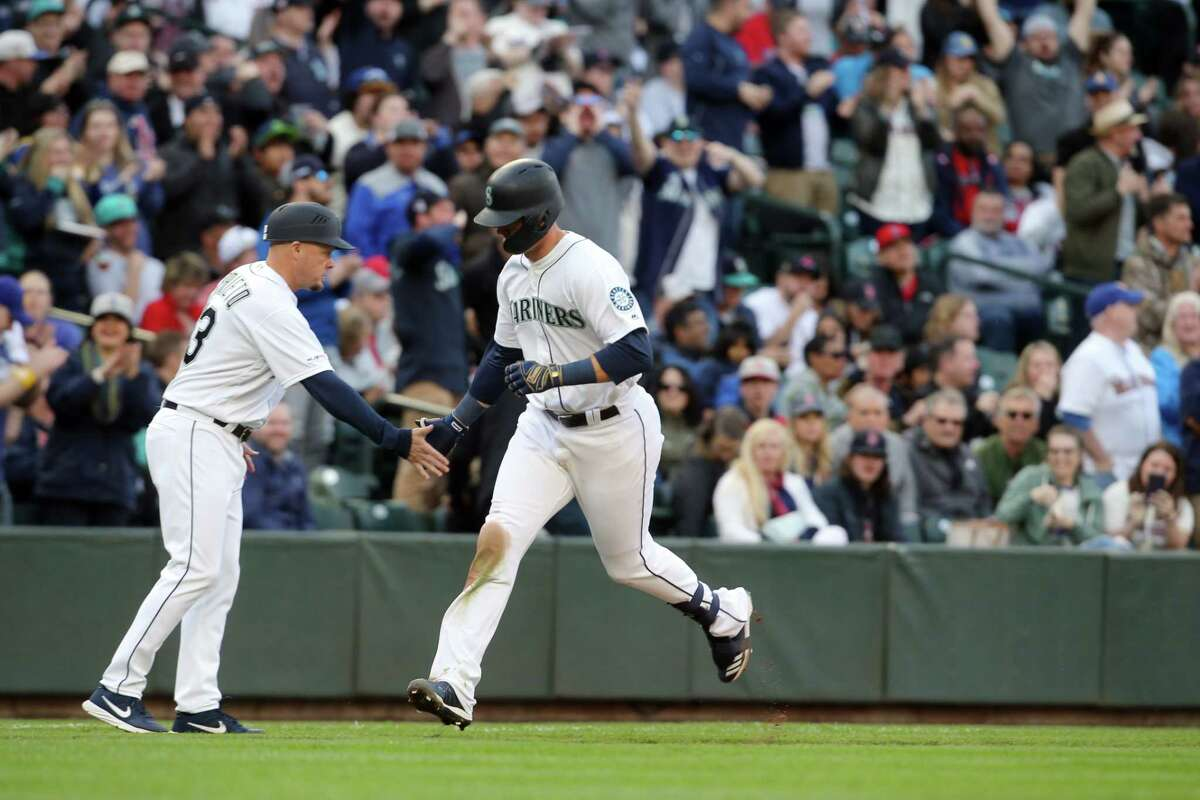 Seattle's Ryon Healy rounds the bases after hitting home run in the 5th inning of the Seattle Mariner's home-opener against the Boston Red Sox at the newly renamed T-Mobile Park, Thursday, March, 28, 2019.