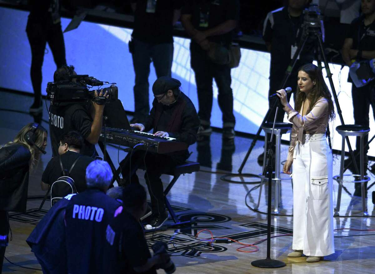 Argentinian singer Michelle LeClercq sings the Argentinian national anthem on the night that San Antonio Spurs legend Manu Ginobili honored with the retiring of his jersey number on Thursday night, March 28, 2019.