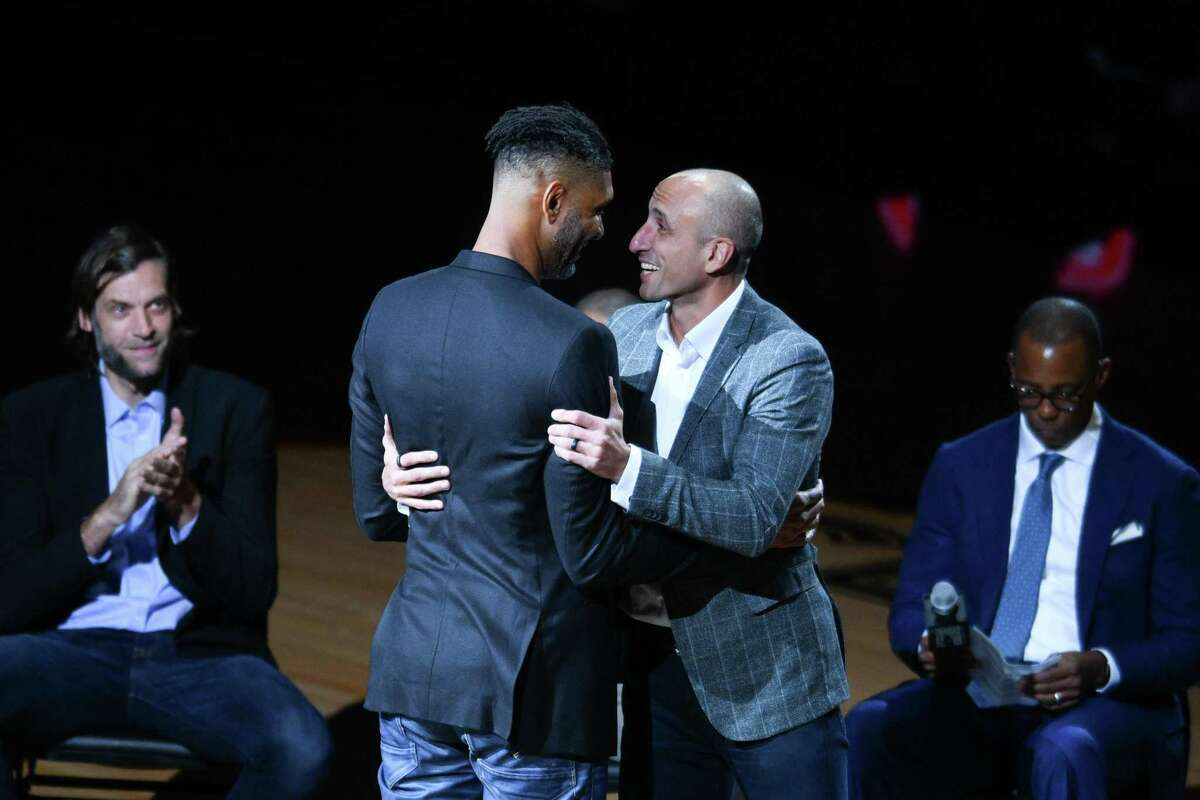 San Antonio Spurs legend Manu Ginoboli is congratulated by former teammateTim Duncan during his number retirement on Thursday night, March 28, 2019, after the Spurs game against the Cleveland Cavaliers. Ginobili played for the Spurs from 2002-2018.