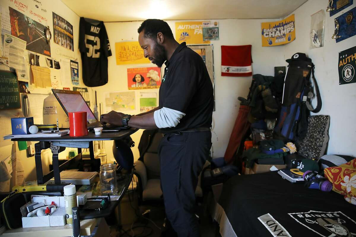 Howard Oliver works out of his East Oakland garage in Oakland, Calif., on Wednesday, March 21, 2019. He is the owner of East Bay Indoor Environmental, LLC. Inside people's homes in East Oakland are local merchants, like Oliver, who have transformed their garages into storefronts or offices and have found a way to bypass the hefty cost of commercial rent by setting up shop in their homes.