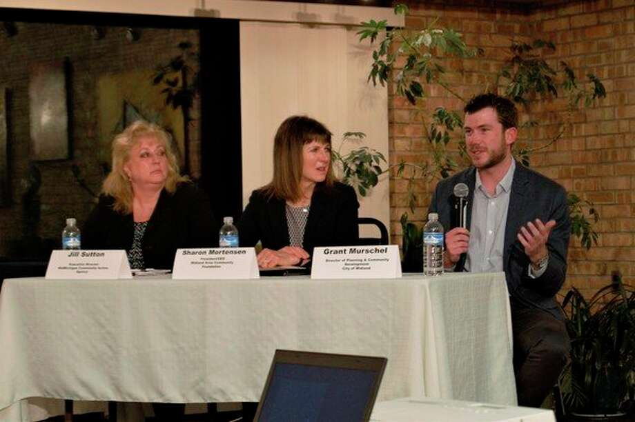 Jill Sutton, Sharon Mortensen and Grant Murschel speak at a panel discussion about housing, hosted by the League of Women Voters of the Midland Area, on March 28 at Creative 360 in Midland. (Ashley Schafer/ashley.schafer@hearstnp.com)