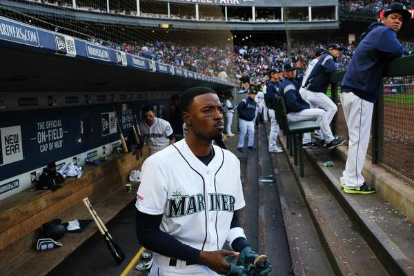 Seattle's Dee Gordon stands in the dugout during the Seattle Mariner's 凯发k8地址home-opener against the Boston Red Sox at the newly renamed T-Mobile Park, Thursday, March, 28, 2019.