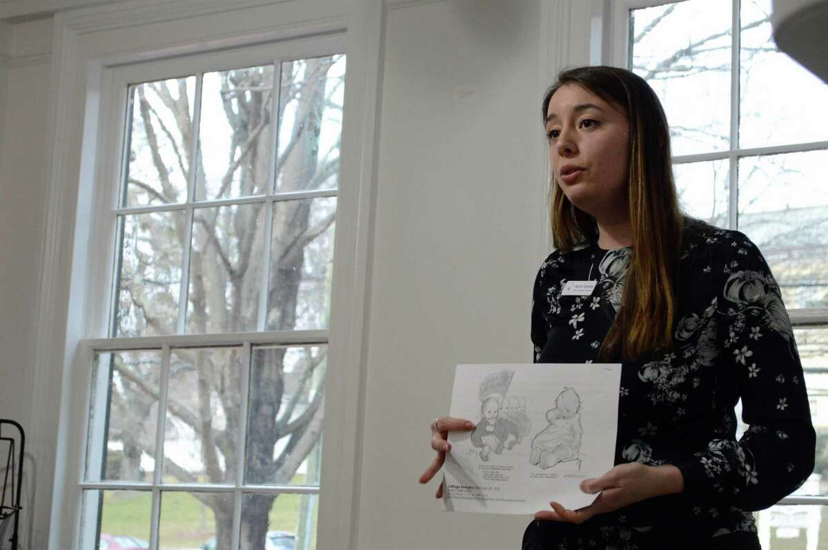"""Nicole Carpenter, director of programs and education, talks about Rose O'Neill, the Westport illustrator who created the Kewpie doll character, and her role as a suffragist at the Westport History Society's """"Saugatuck Social"""" on Thursday, March 28, 2019, in Westport, Conn."""