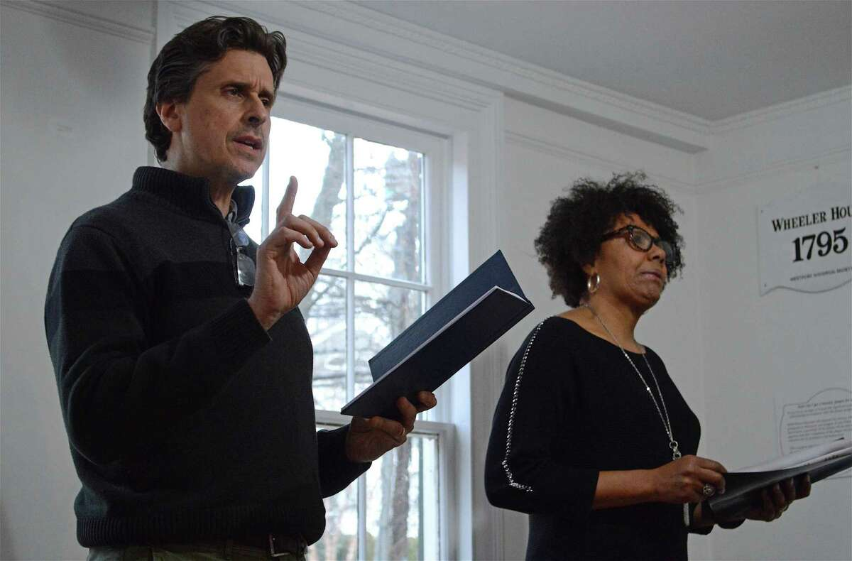 """Greg Porretta of Westport performs as Thomas Dew in a dialogue with Kimberly Wilson of Westport playing Sojourner Truth at the Westport History Society's """"Saugatuck Social"""" on Thursday, March 28, 2019, in Westport, Conn."""