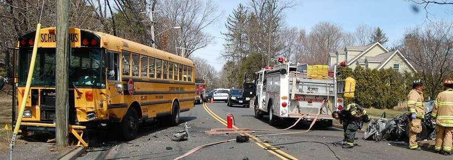 An 82-year-old woman crashed head-on into a school bus on Newfield Avenue early Thursday afternoon. The woman was seriously injured. The bus driver and a high school age student were not injured. Photo: Stamford Police / Contributed