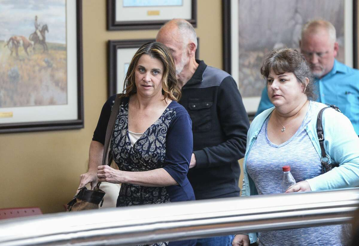 Kelly Daws leaves a Jefferson County courtroom with her father and a friend during a break on Thursday as the jury began deliberations. She was later convicted and sentenced to 12 years in prison for conspiracy to have her estranged husband killed in 2016. Photo taken on Thursday, 03/28/19. Ryan Welch/The Enterprise